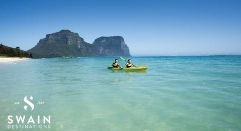 A couple enjoying a scenic kayak by Lagoon Beach on Lord Howe Island