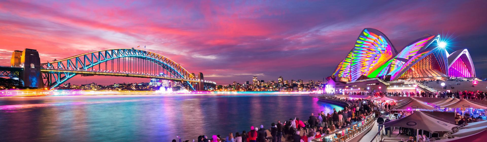 Patrons at Opera Bar enjoying the sunset and light projections during Vivid Sydney 2018